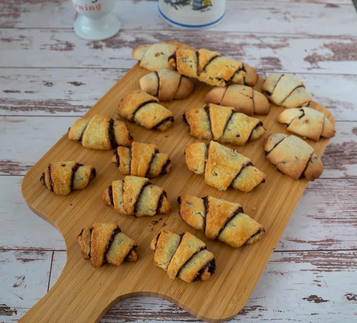Chocolate rugelach on a wooden tray.