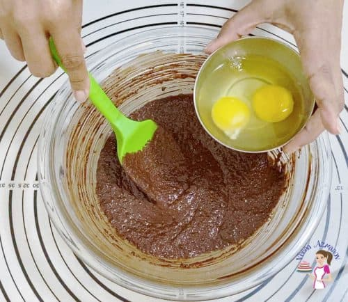 Add eggs to the melted chocolate