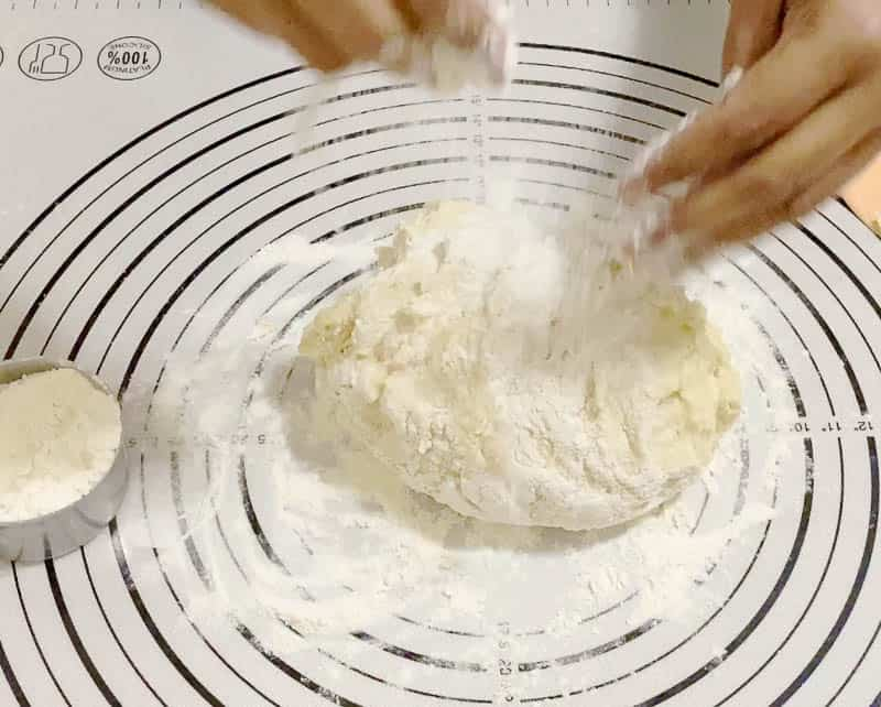 Kneading the dough for the braided challah