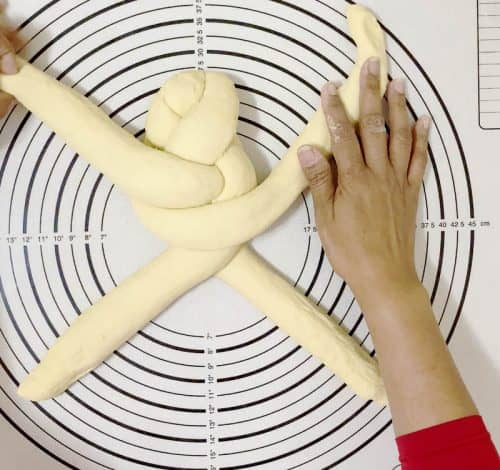 Braiding the four strands of challah - hala bread
