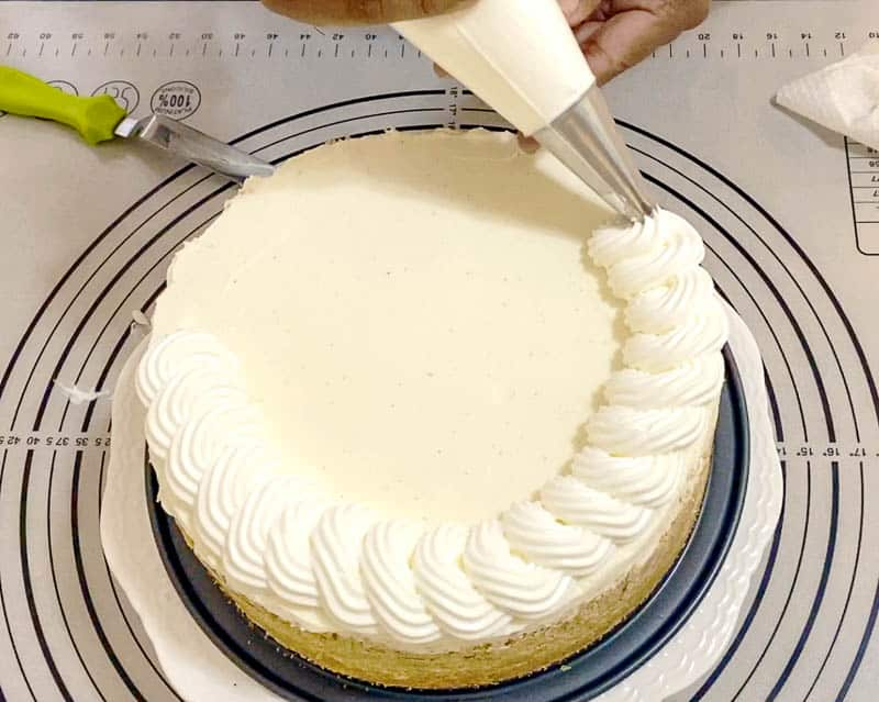 Pipe the whipped cream over the chilled cheesecake