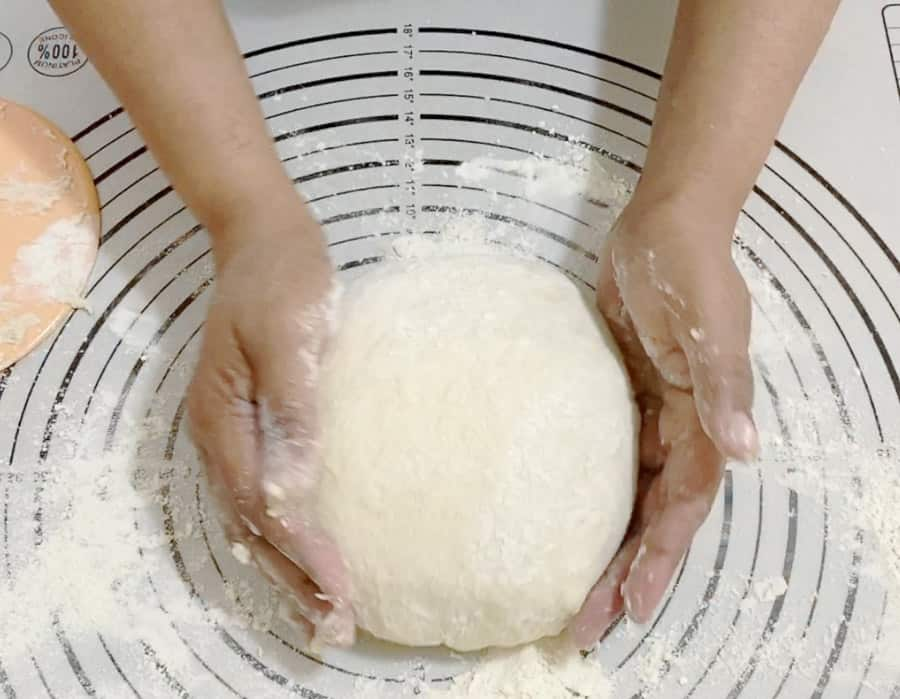 Shape the no-knead dough into the baking pan for bread