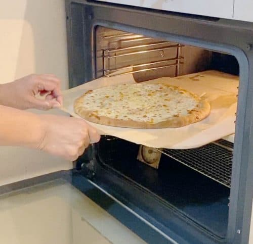 Use the pizza peel to remove the pizza from the oven