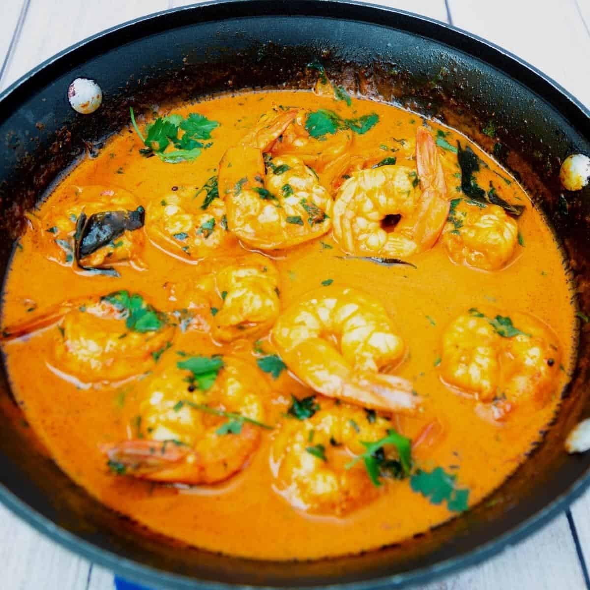Skillet with prawn shrimp curry.