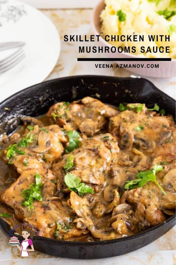 A skillet of chicken and mushrooms sauce.