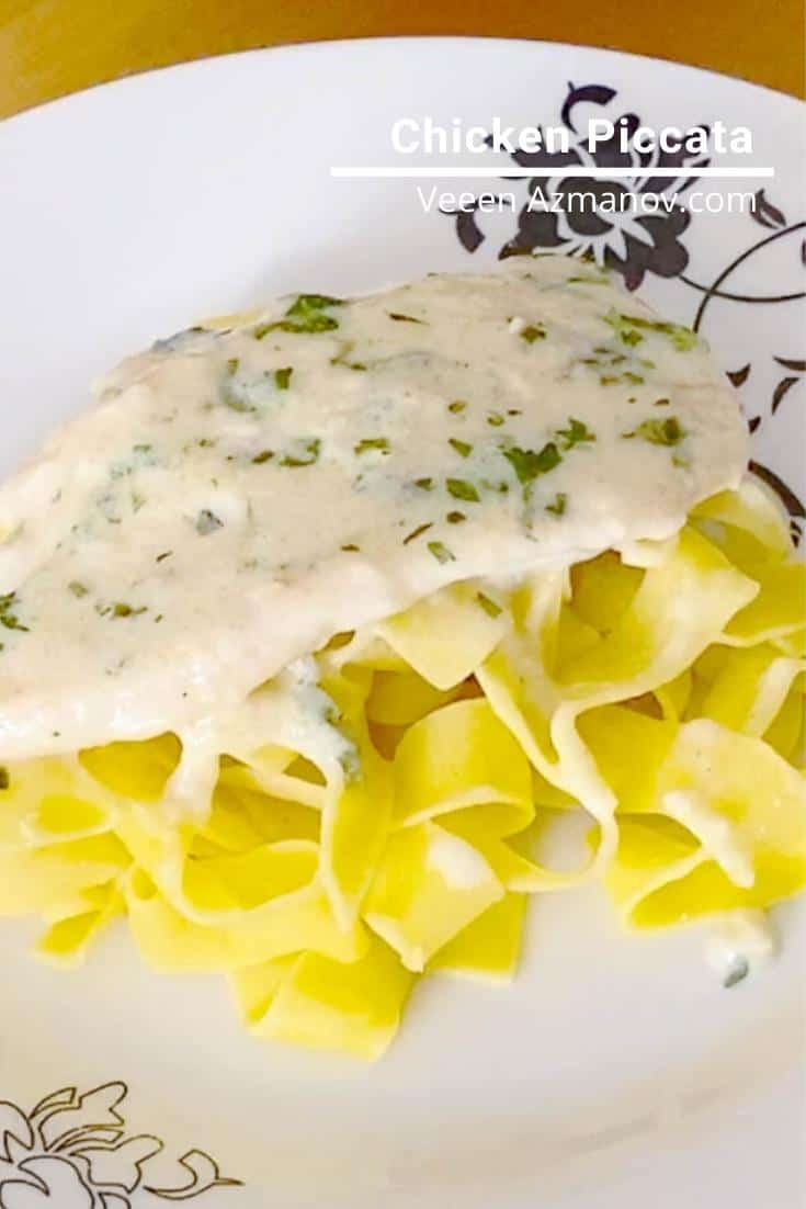 A plate of chicken piccata and pasta.