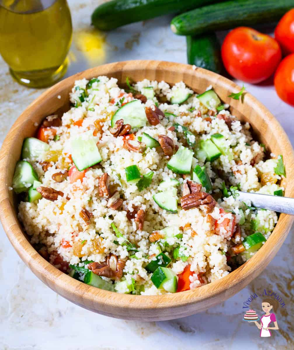 A bowl of couscous and salad.