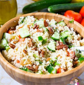 A wooden bowl with couscous salad.