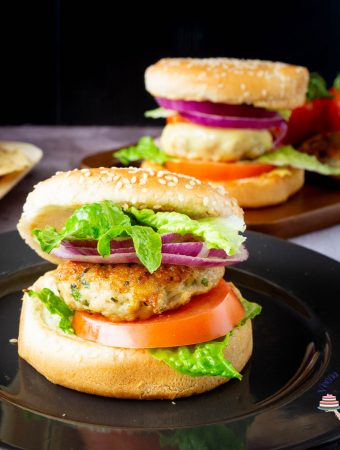 Two burgers made with ground chicken patties and cheese