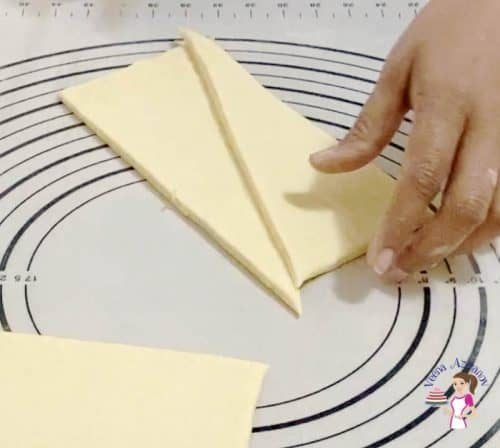 Roll the dough into a rectangle for croissants