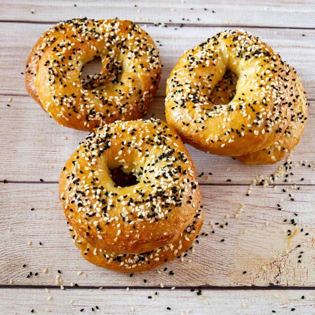 Bagels on a wooden table.