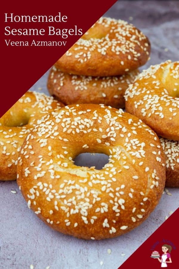 A close up of a stack of sesame bagels on a table.