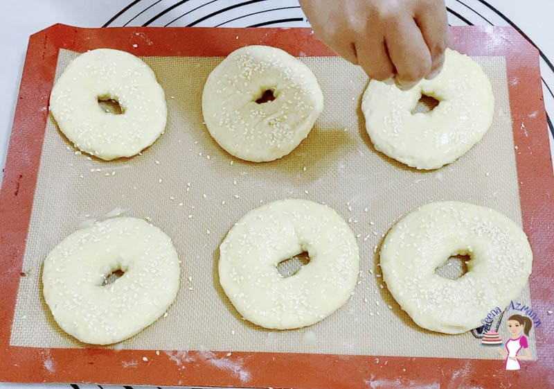 Top the bagels with sesame seeds