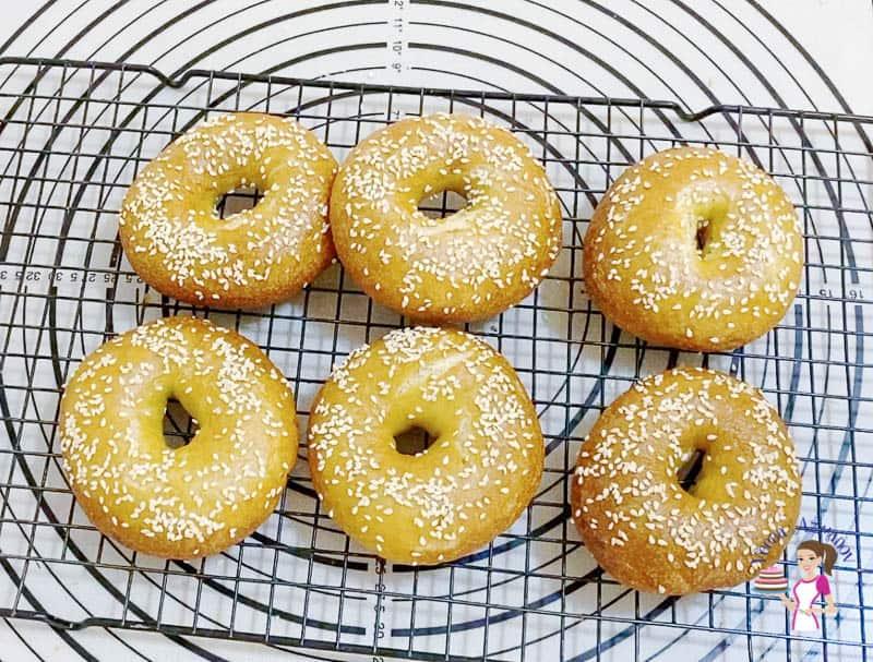 sesame bagels on a cooling rack.