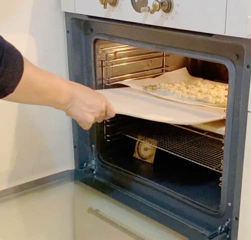 Put the pizza in the oven with white sauce