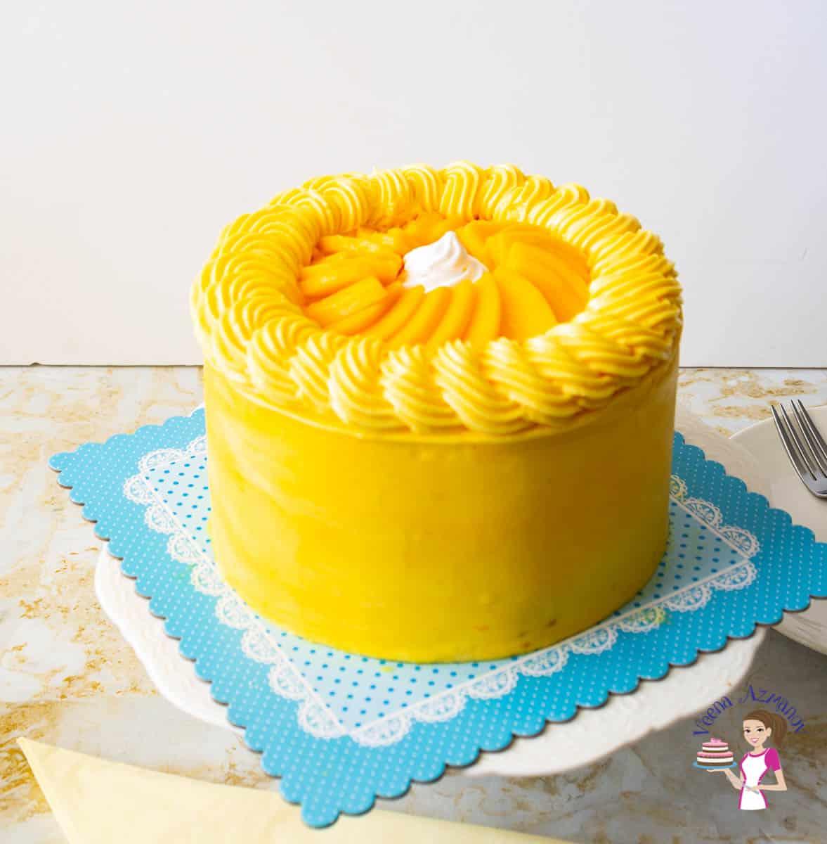 Mango cake on a cake stand.