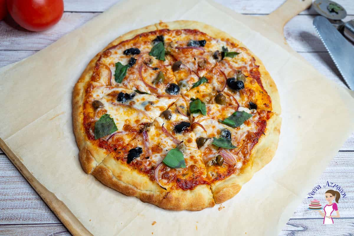 How to make pizza at home with homemade pizza crust and pizza sauce topped with olives and onions