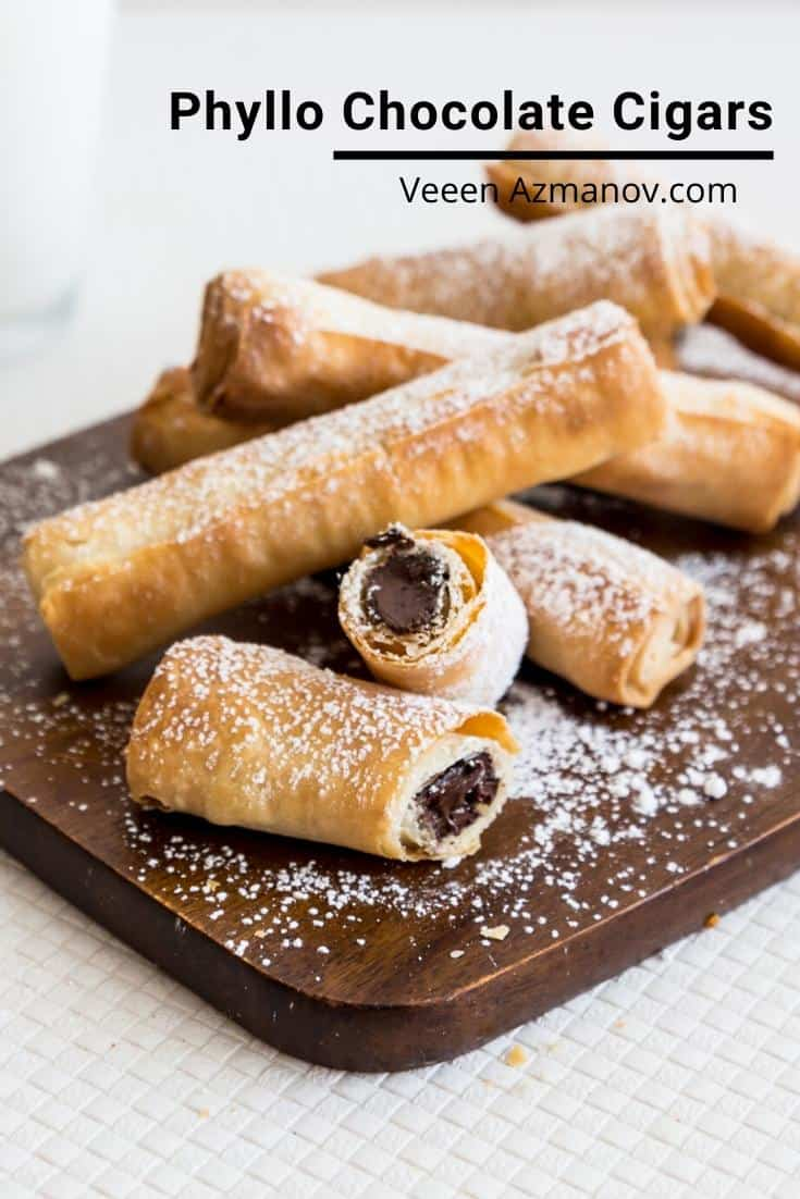 Flaky, crispy phyllo chocolate cigars are filo pastry filled with chocolate, rolled into a cigar shape then baked until golden. Simple, elegant treats that get done in less than 15 minutes. #chocolatepastry #chocolatecigars #chocolatedessert #chocolate #pastry #phyllo via @Veenaazmanov