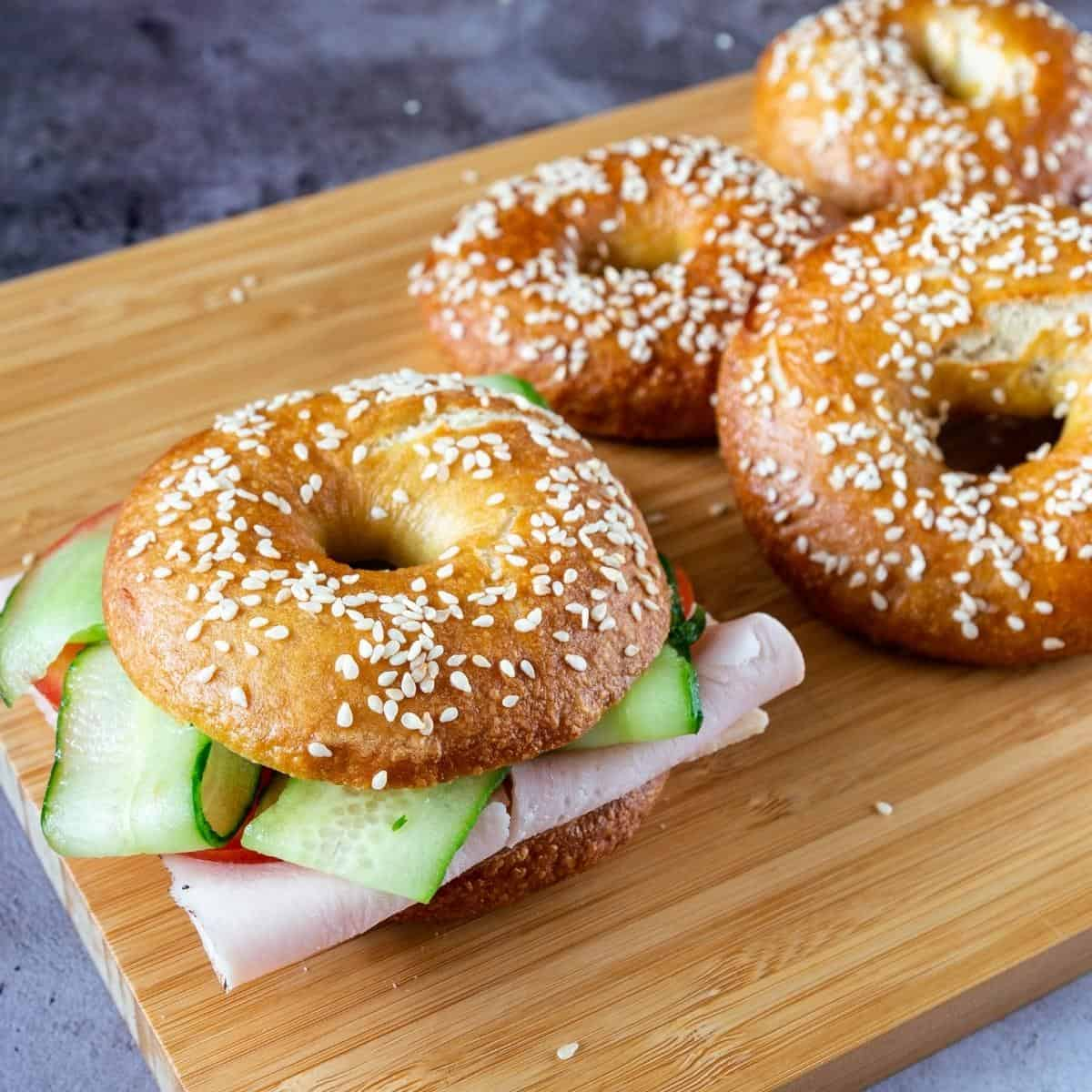 Bagels sandwich on a table.