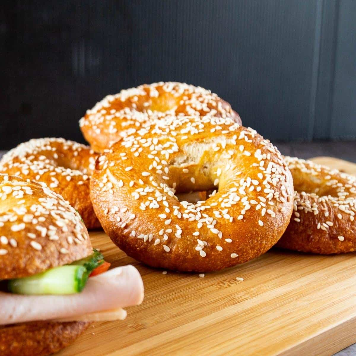 Sesame bagels on a table.