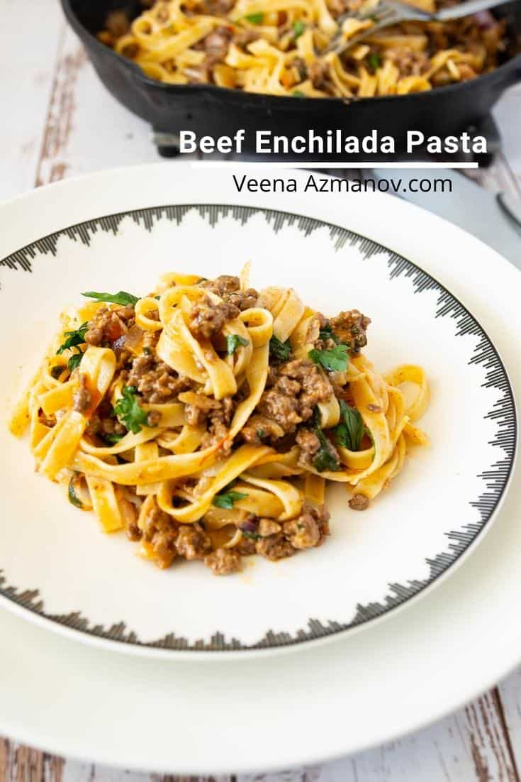 A plate of pasta with ground beef.