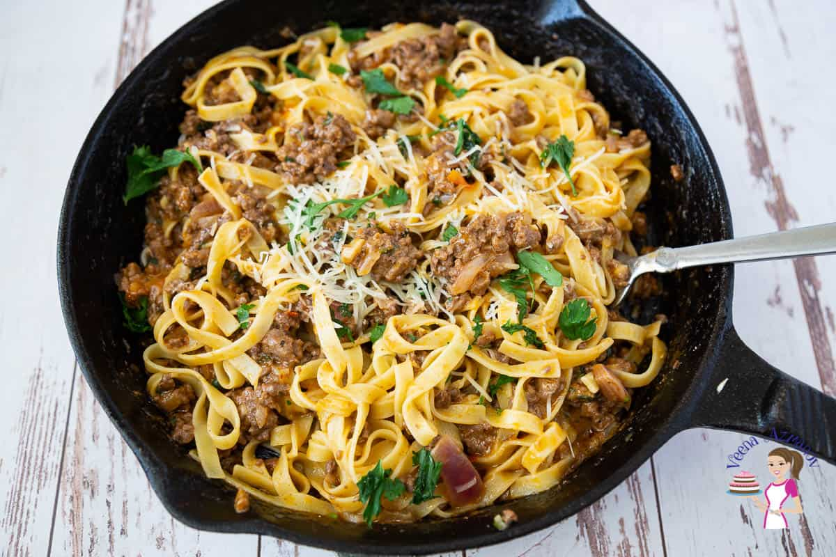 A skillet of pasta with ground beef.
