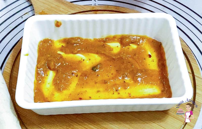 Place the enchiladas in a baking dish for baking.