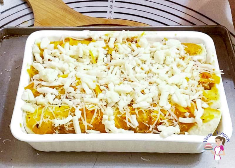 Top the enchiladas with cheese and bake some more