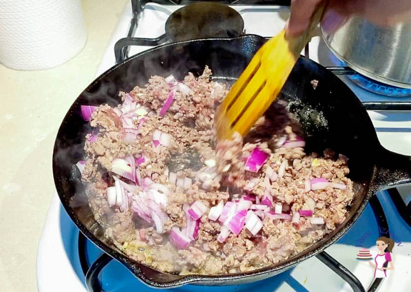 Add the onions and garlic to the ground beef