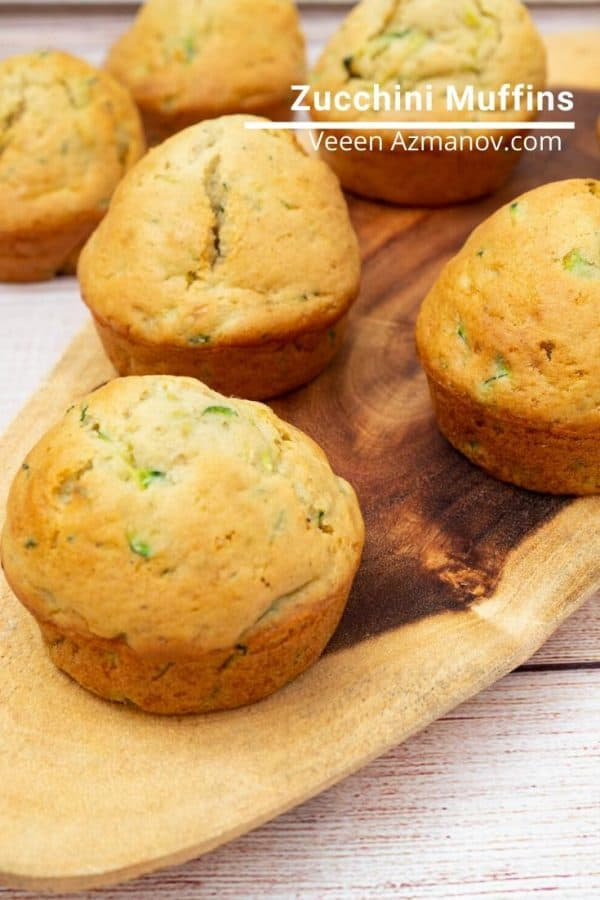 Zucchini muffins on a wooden tray.