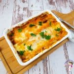 Beef enchilada in a rectangular baking dish.