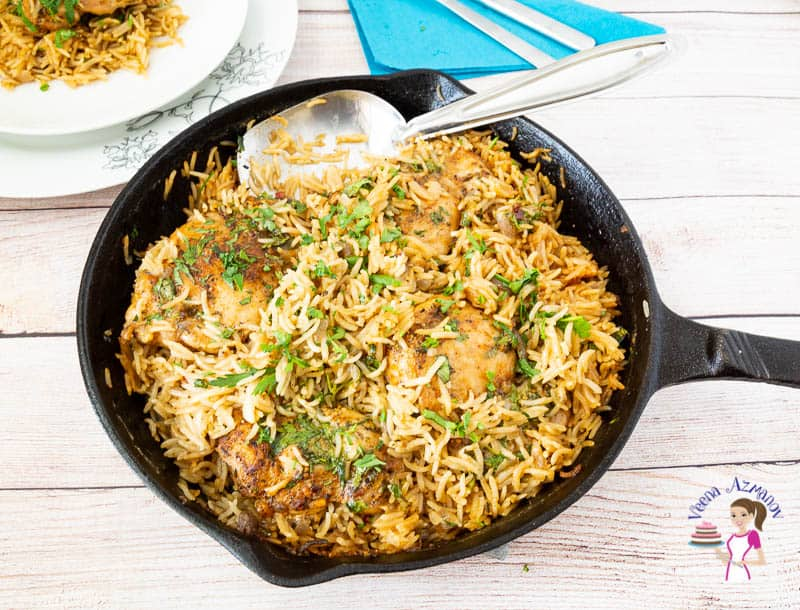 A skillet with chicken and rice.