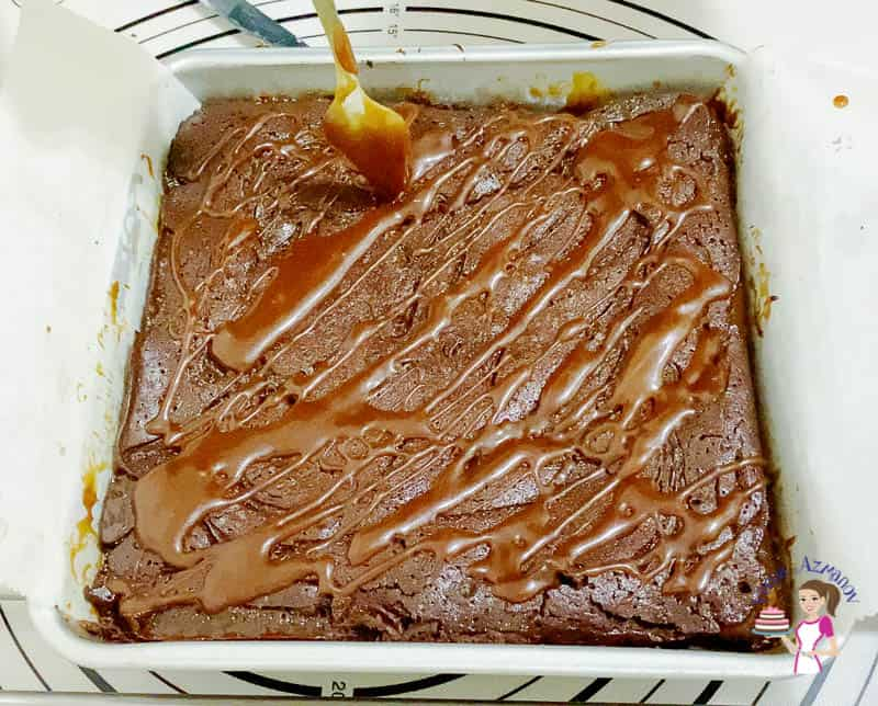 Drizzle the warm brownies with caramel sauce