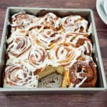 Cinnamon rolls in a square baking tray.