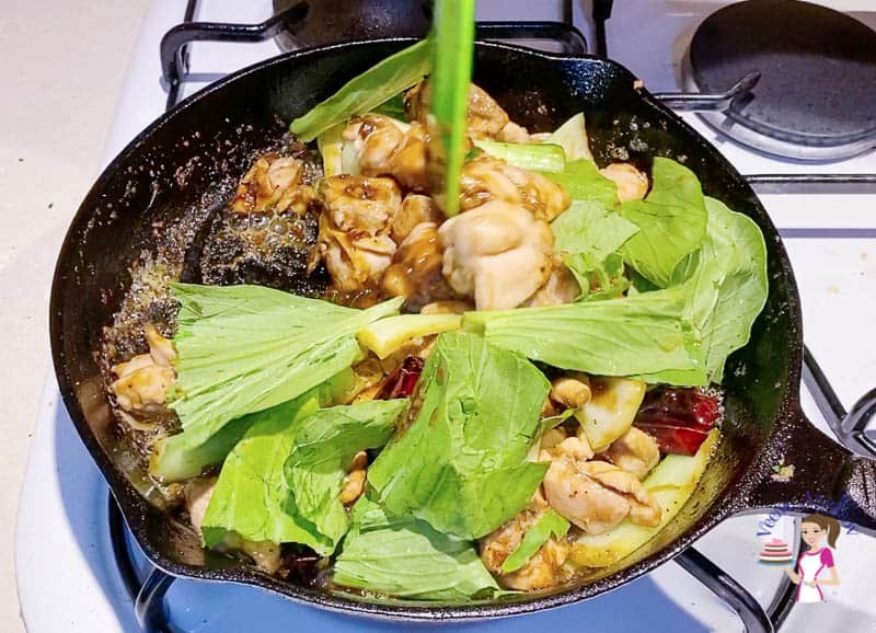 Add the boy choy leaves to the kung pao skillet