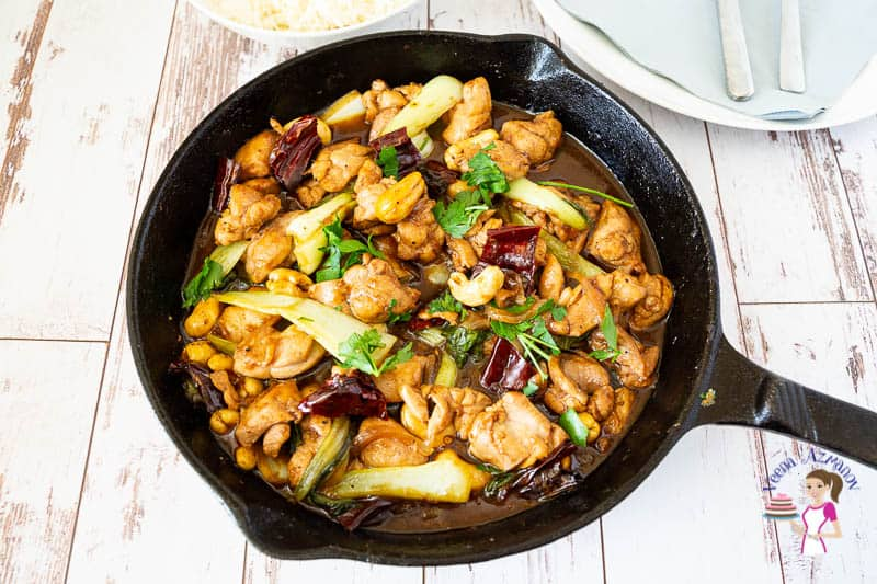 A skillet with kung pan chicken with rice.