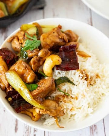 A bowl of kung pan chicken with rice.