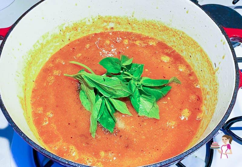 Add the salt, pepper, and basil in the sauce marinara