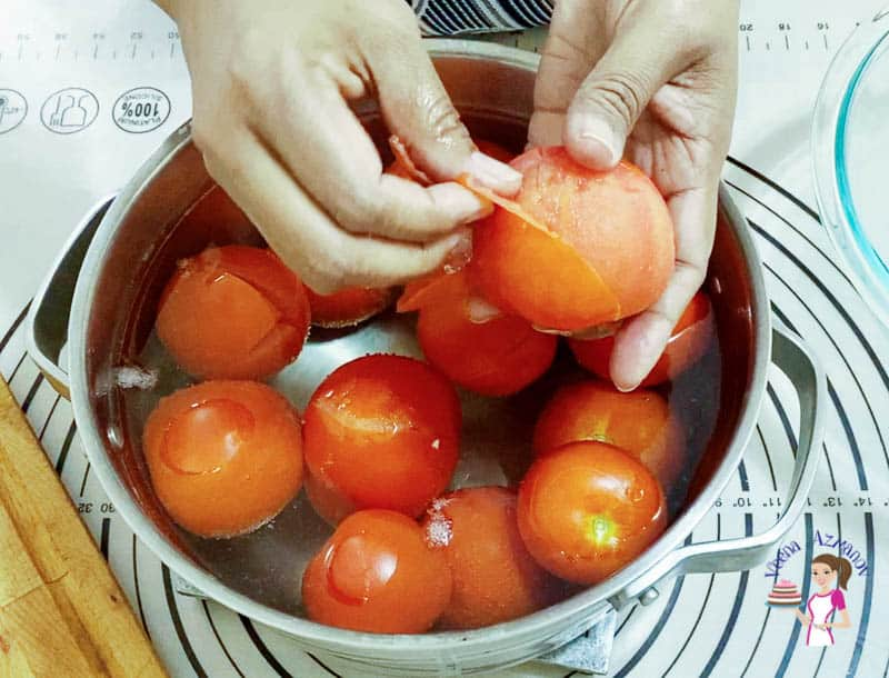 Skin the tomatoes for the marinara
