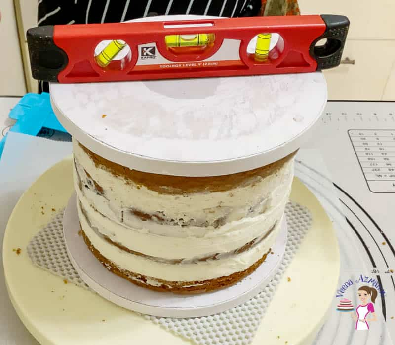 A leveler on top of a layer cake.