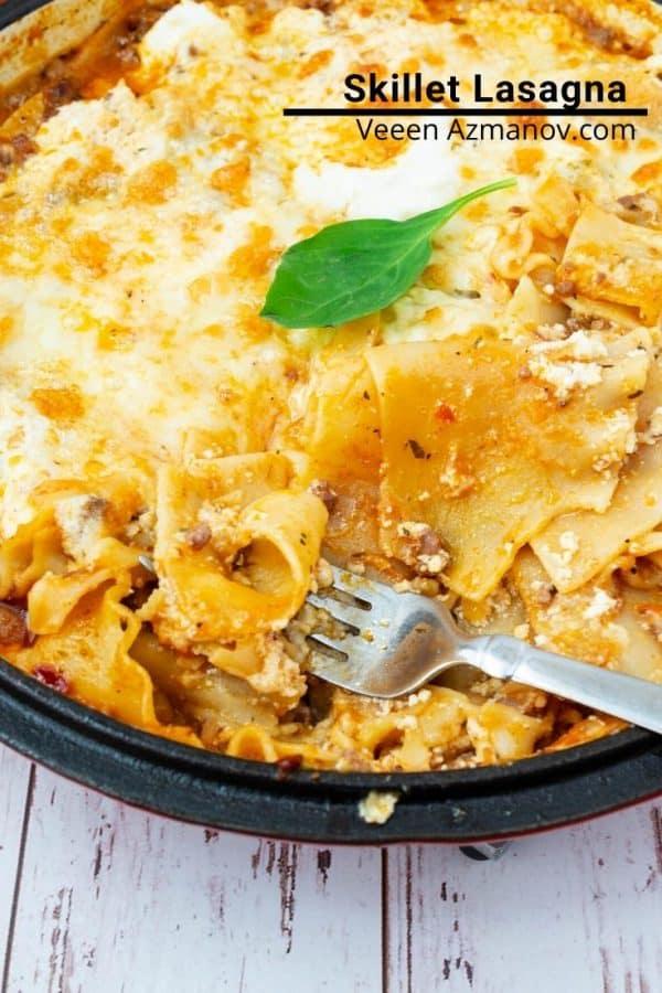 A close up of lasagna in a skillet.