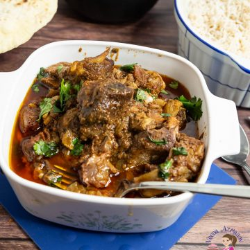 Slow cooked lamb curry in a serving bowl.