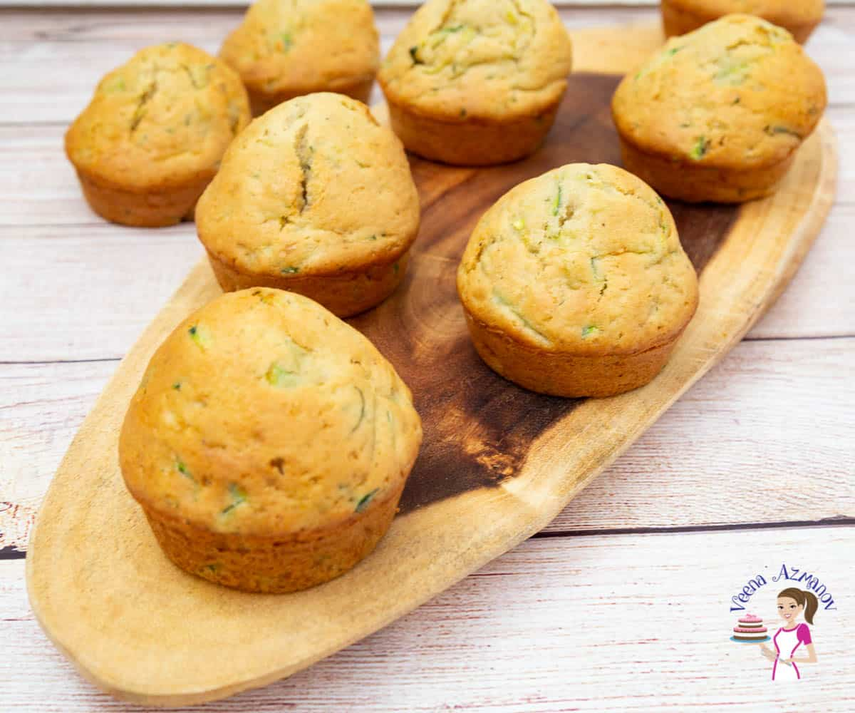 Muffins on a wooden tray.