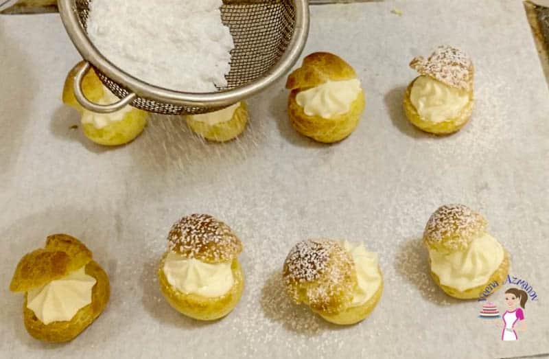 Dust the cream puffs with powdered sugar