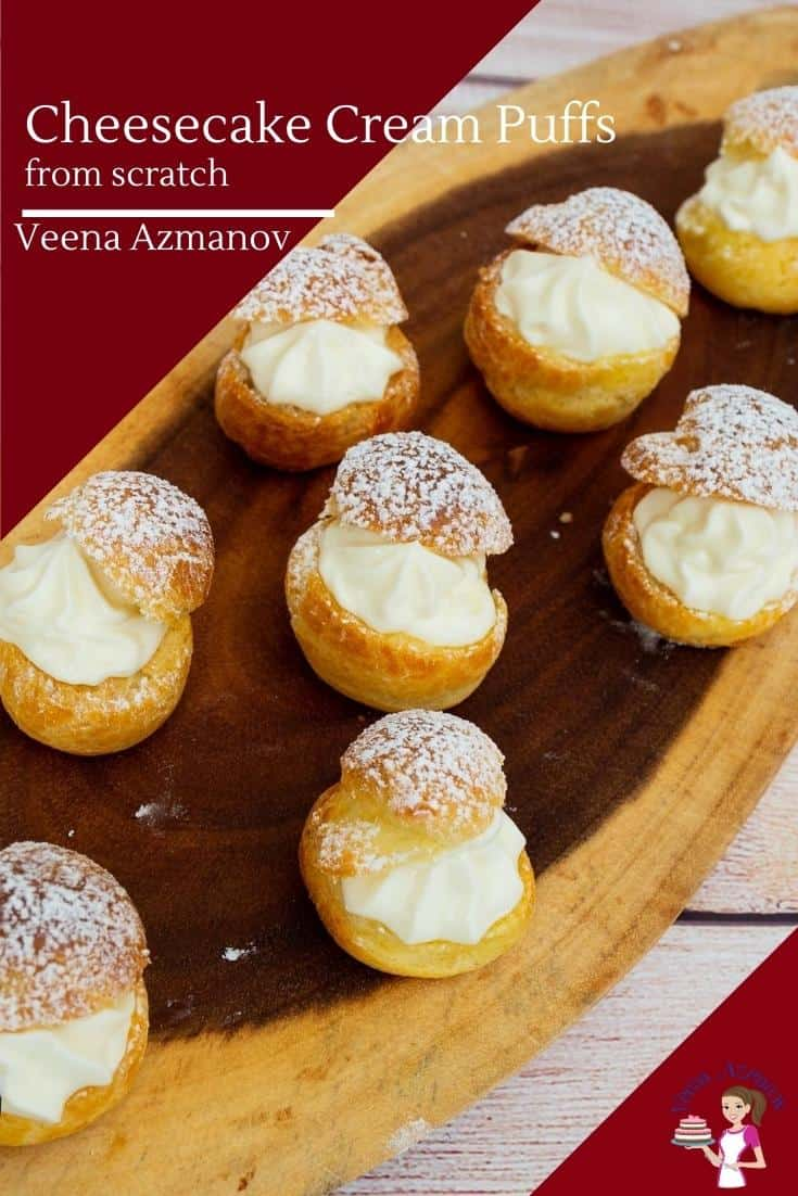 Cheesecake cream puffs on a wooden tray.