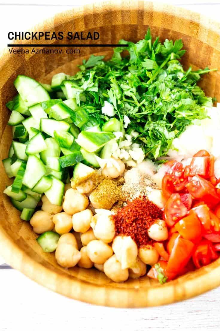 A wooden bowl with chickpeas salad.