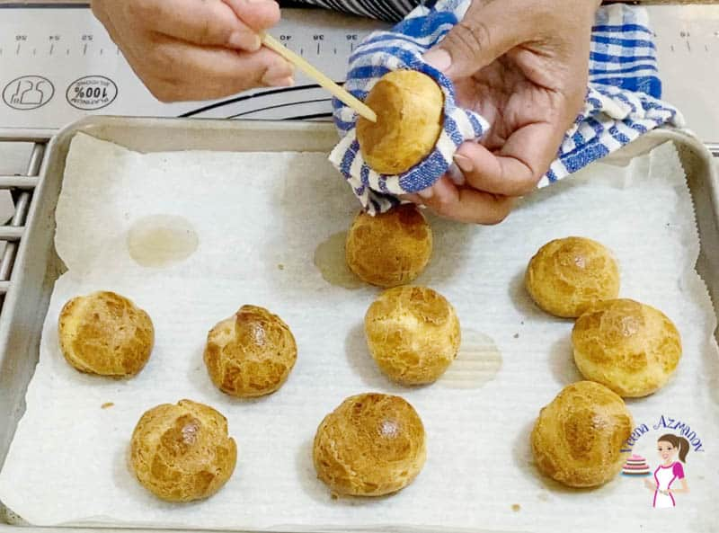 Prick a hole under each choux pastry base