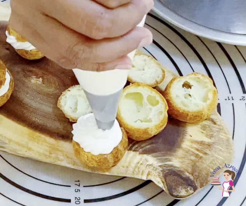 Fill the cream puffs with whipped cream