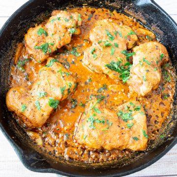 creamy paprika chicken tenders in a skillet.