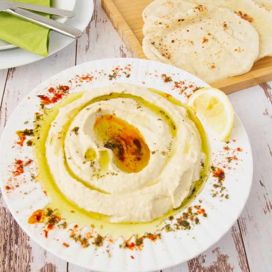 Hummus in a plate with olive oil.